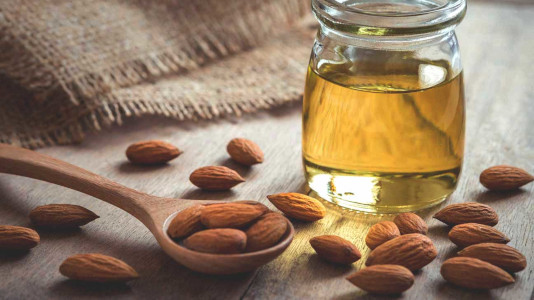 cold pressed almond oil and almonds